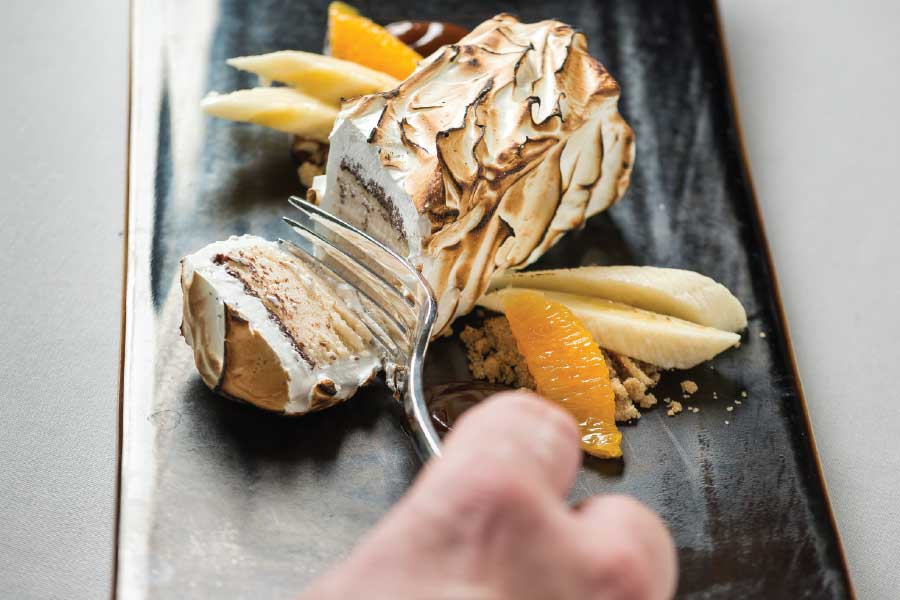 Baked alaska filled with peanut butter ice cream and torched for mere seconds at order. (Photo by Rey Lopez)