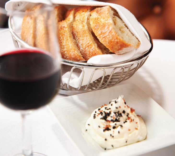 A trio of maldon and red and black Hawaiian lava salts atop the butter make it hard to ignore the bread basket. (Photo by Jonathan Timmes)