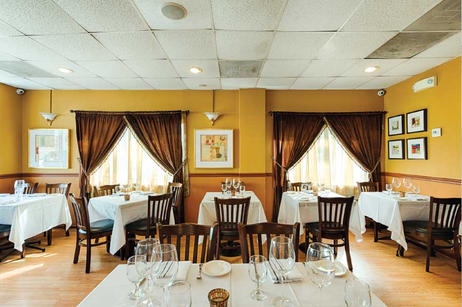 The quaint dining room of Fairfax City's Le Mediterranean Bistro (Photo by Rey Lopez)