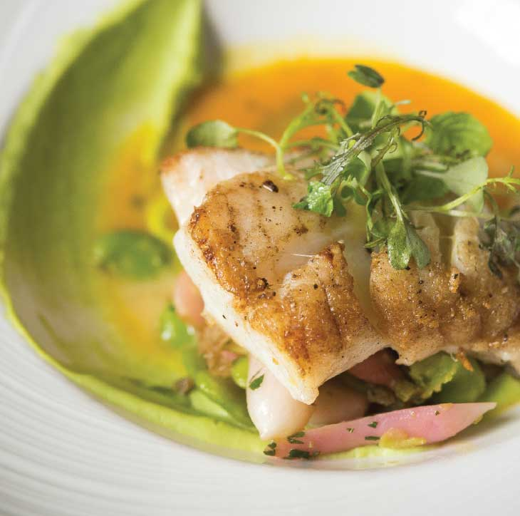 A springy plate with north Atlantic cod and of-the-season vegetables. (Photo by Rey Lopez)